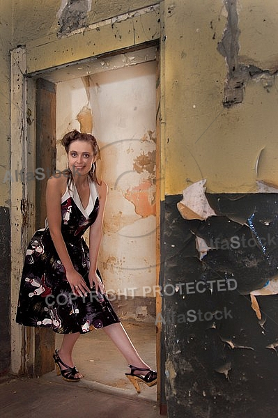 Girl with black dress in an old building