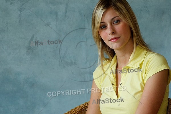 Girl with blonde hair sitting