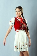 Girl with brown hair and national costume