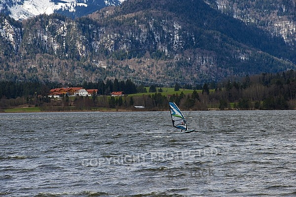 Surfer in the strom, Hopfensee, Bavaria, Germany
