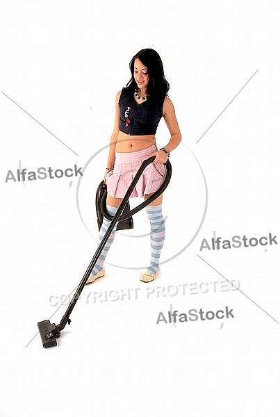 Yung girl with vacuum cleaner. White background